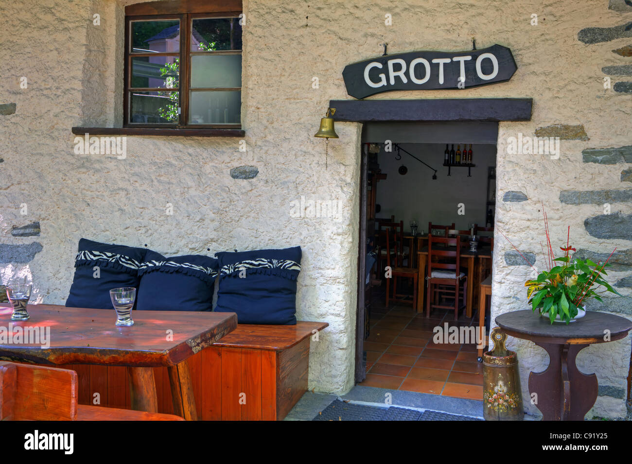 simple patio of a typical Ticino Grotto - Stock Image