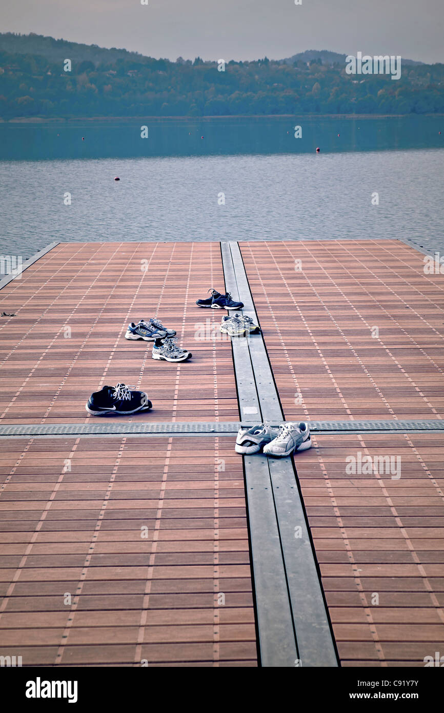 multiple sneakers on a pier - Stock Image