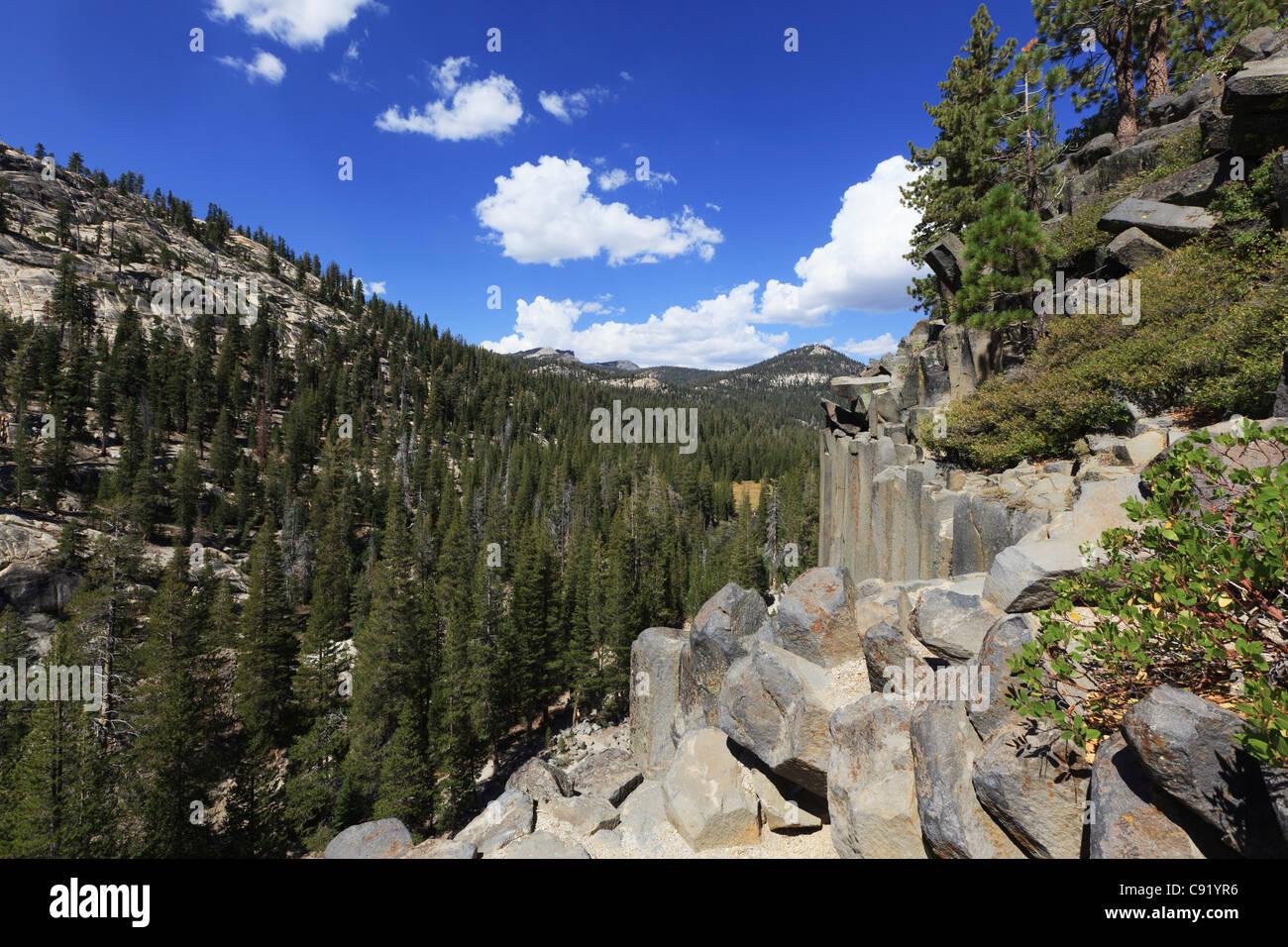 Basalt columns at Devils Postpile National Monument in California mountains - Stock Image
