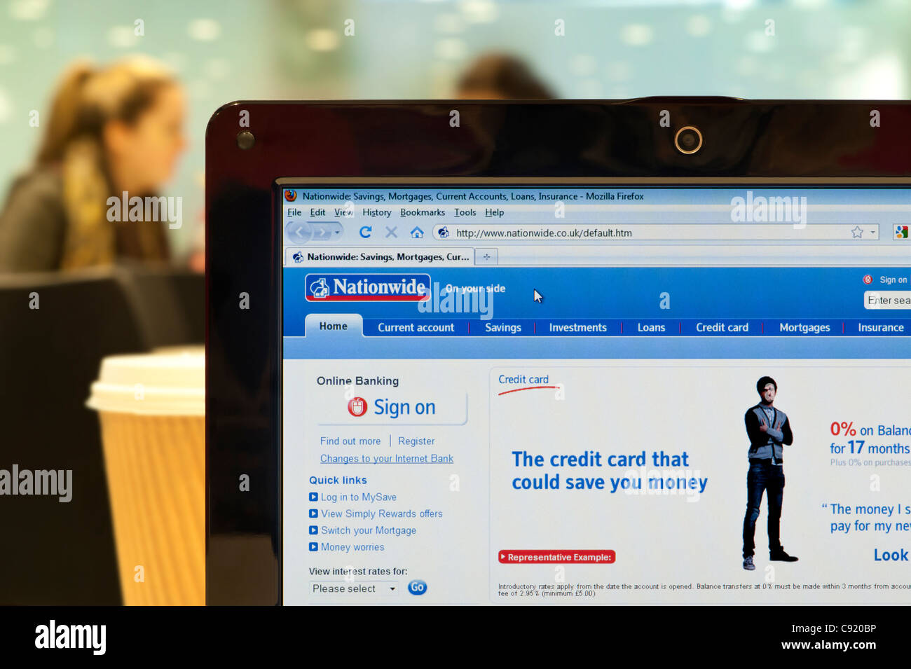 The Nationwide website shot in a coffee shop environment (Editorial use only: ­print, TV, e-book and editorial - Stock Image