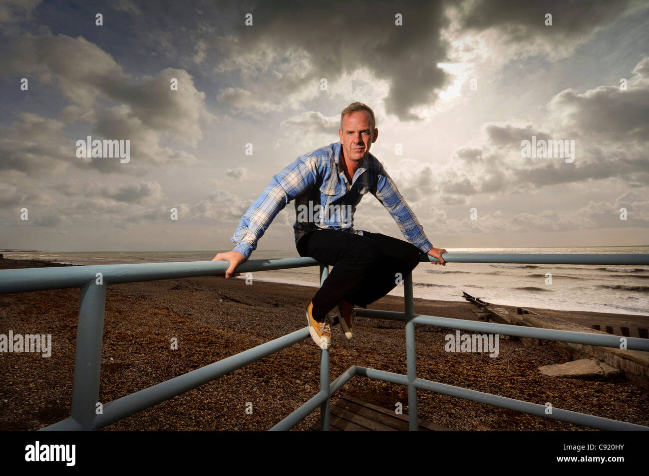 Norman Cook aka Fatboy Slim at his Brighton beach front home in East Sussex UK. - Stock Image