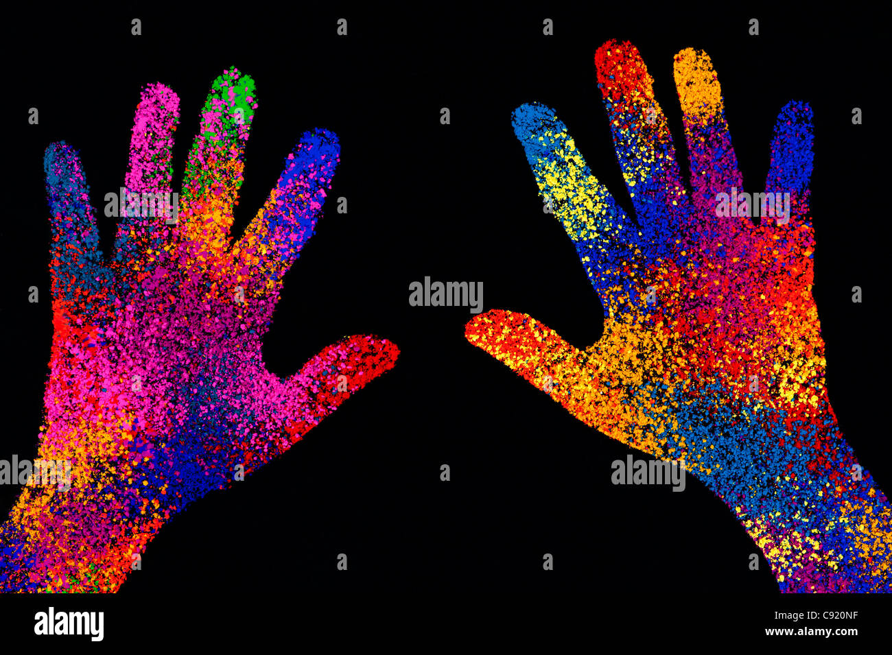 Childs multicoloured hand print on black background - Stock Image