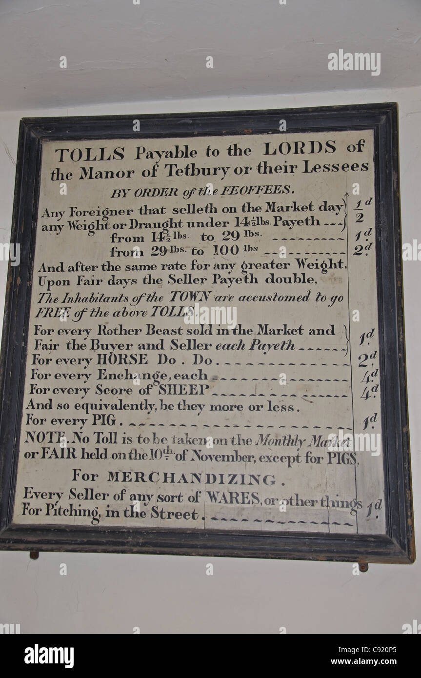 Tolls sign in 17th century Market House, Market Place, Tetbury, Cotswold District, Gloucestershire, England, United - Stock Image