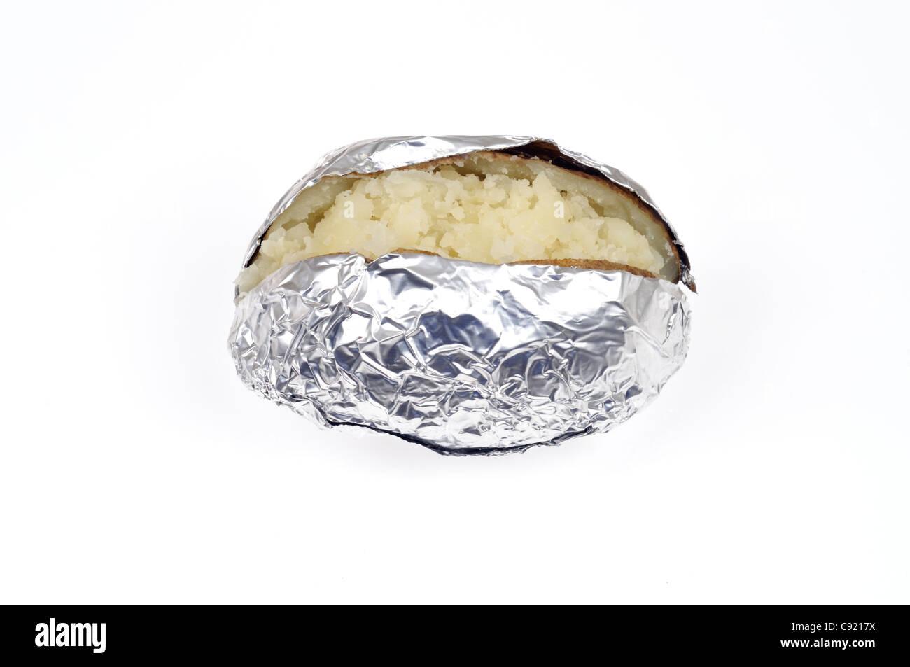 Cooked plain baked jacket potato wrapped aluminum foil on white background cutout. - Stock Image