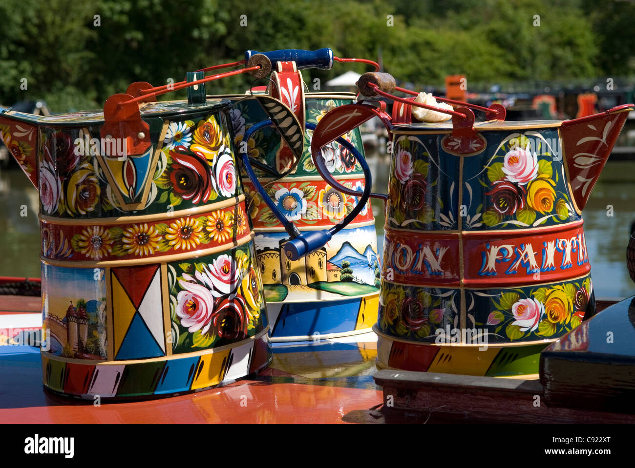 Grand Union Canal. Colourful painted pots on a narrowboat at the Braunston Historic Narrowboat rally 2011. - Stock Image