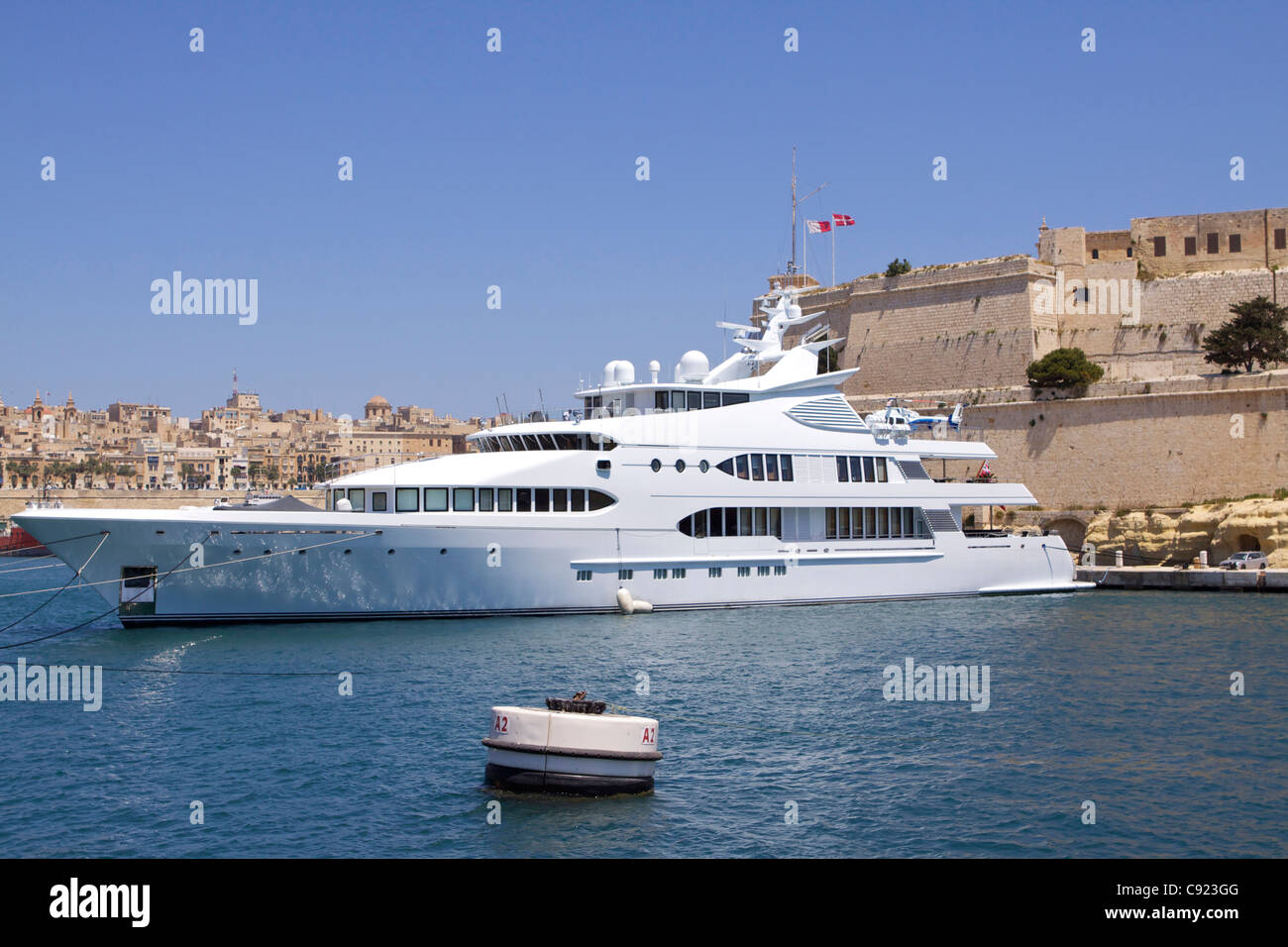 A luxury charter motor yacht complete with helicopter, designed and built in England, and moored in Grand Harbour Stock Photo