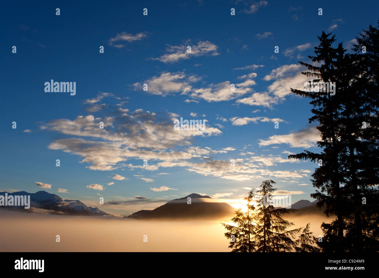 Fog blankets the lowlands at sunrise on Douglas Island near Juneau, Tongass National Forest, Inside Passage, Alaska, - Stock Image