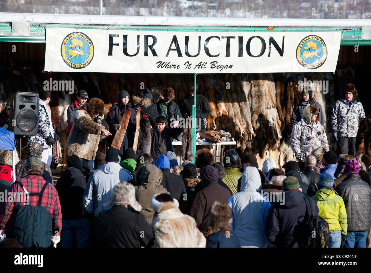 Crowds at the fur auction during 2011 Fur Rondy festival in downtown Anchorage, Southcentral Alaska, Winter Stock Photo