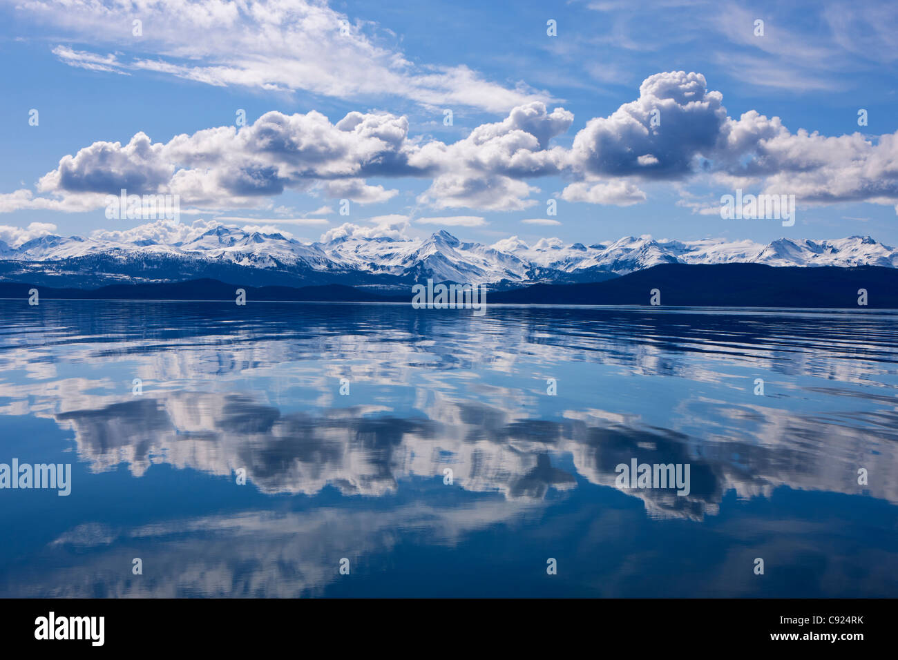 Scenic view of the Chilkat Mountains reflecting in Lynn Canal, Inside Passage, Juneau, Southeast Alaska, Spring - Stock Image