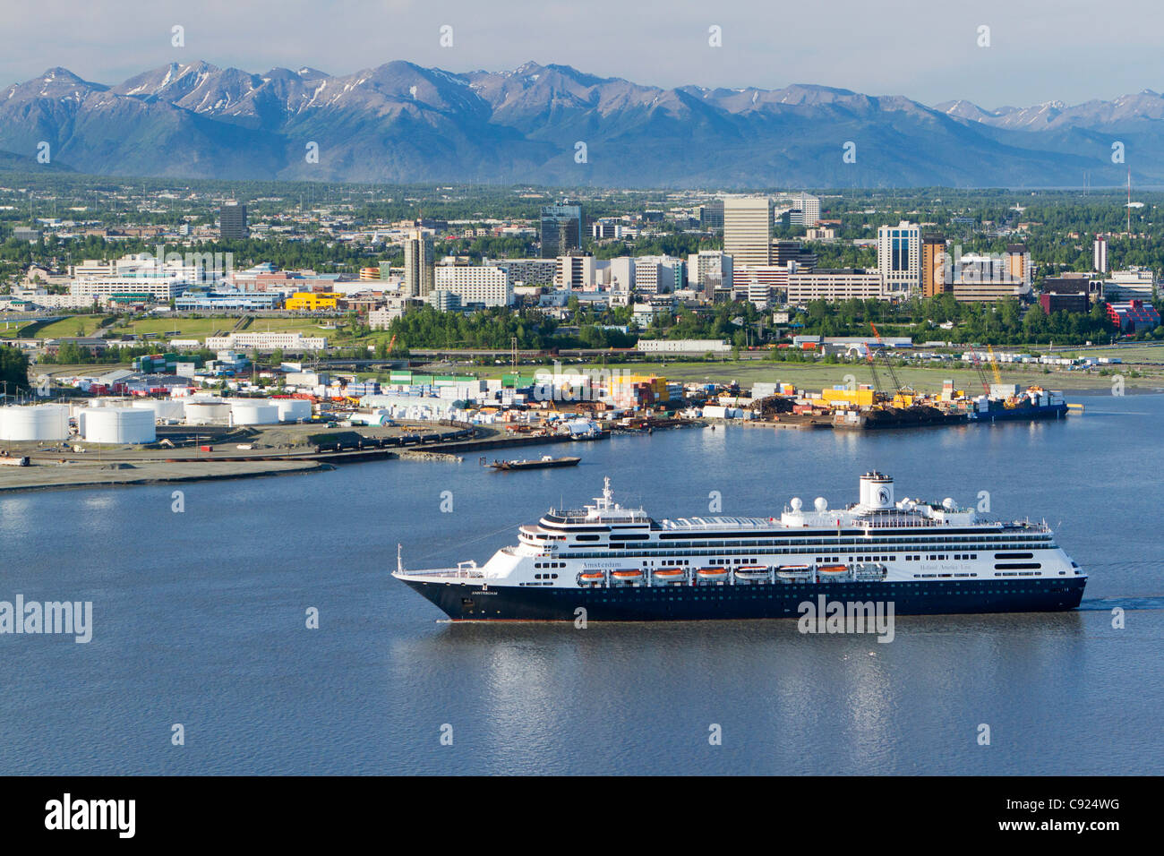 Holland America cruise ship Amsterdam arrives in Cook Inlet with downtown Anchorage in the background, Southcentral - Stock Image