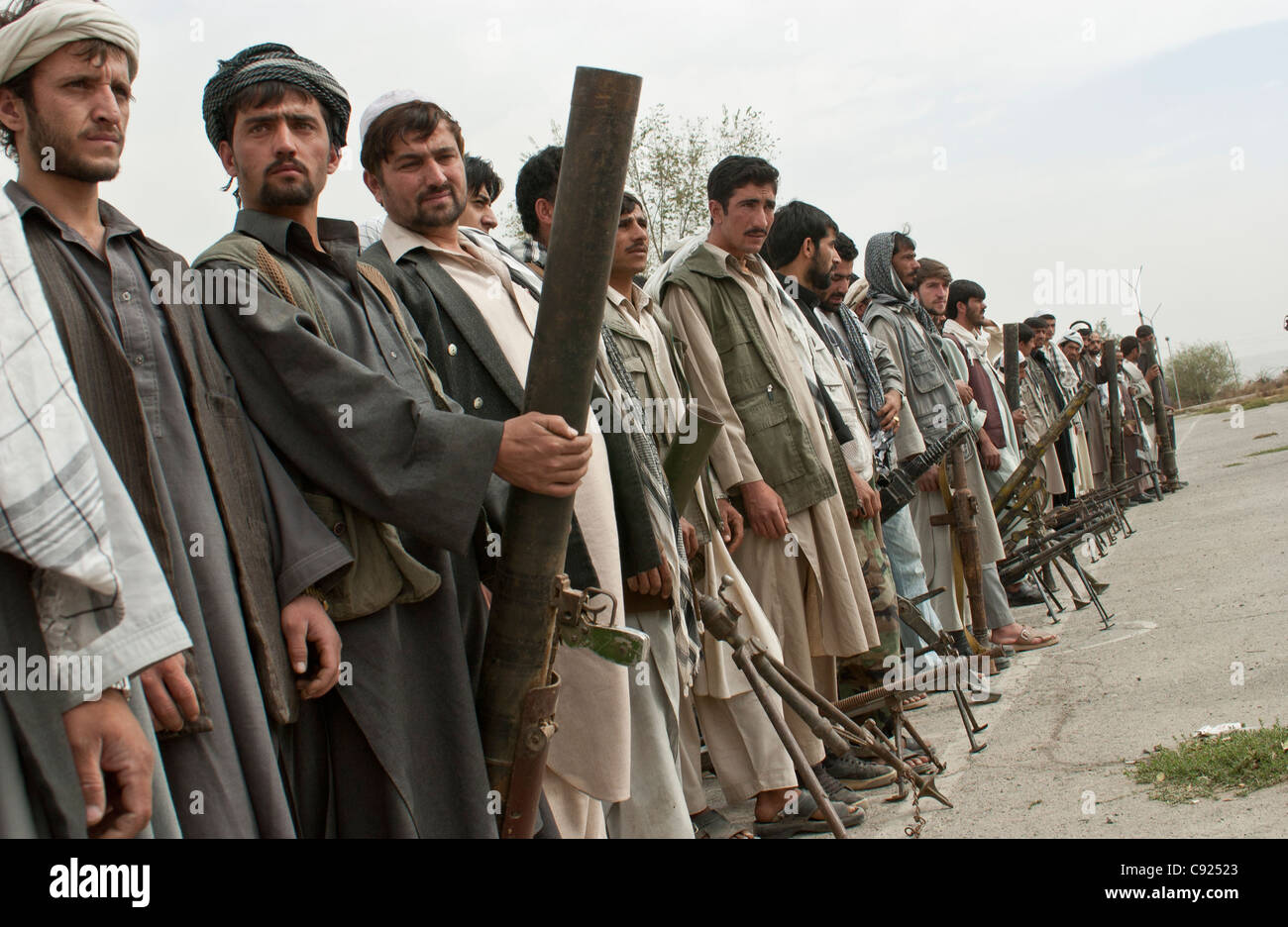 Former militia fighters gather at an army base, as part of a UN DDR program in Kabul, Afghanistan Stock Photo