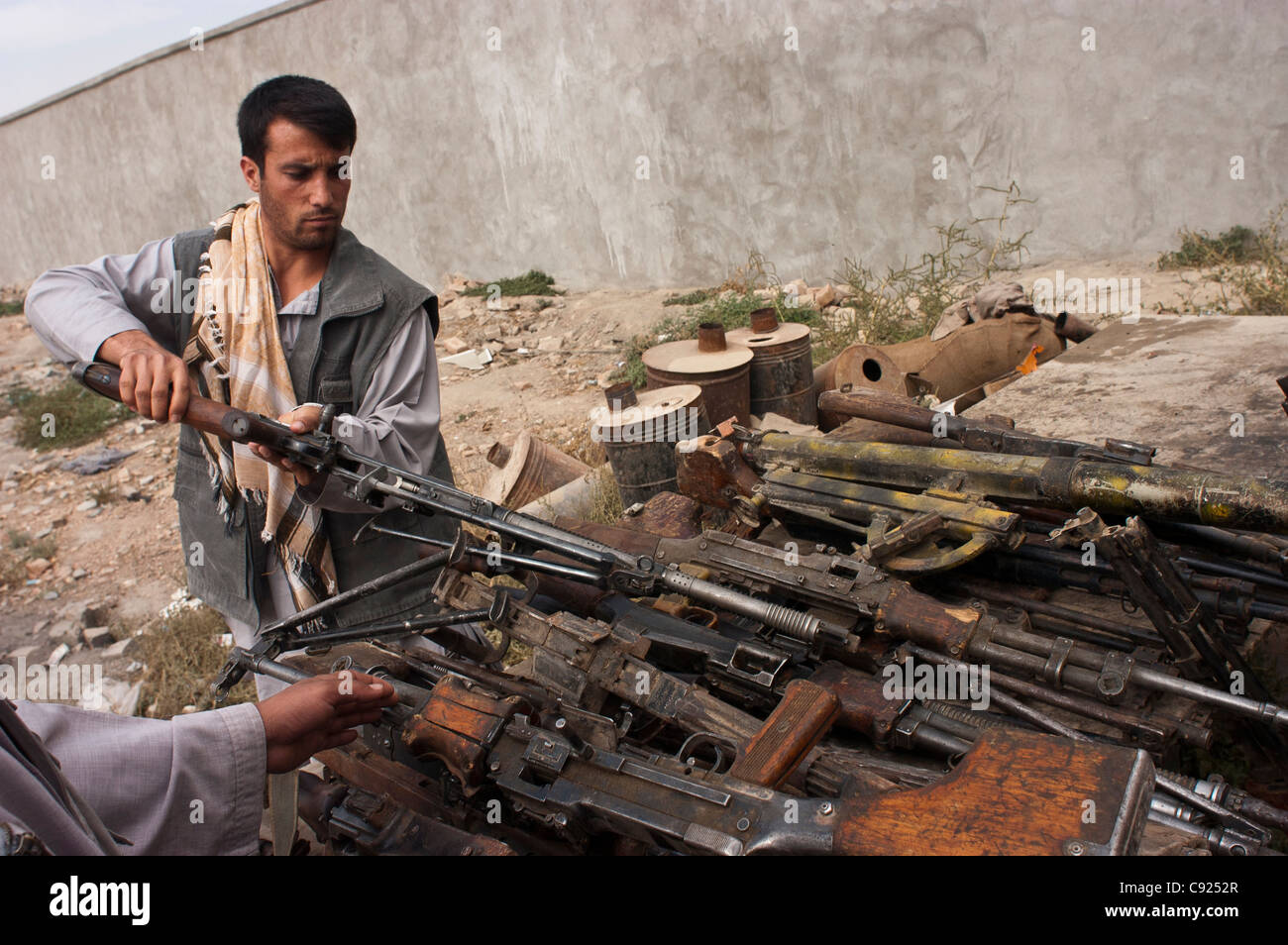 Former militia look at weapons at an army base, as part of a UN DDR program in Kabul, Afghanistan Stock Photo