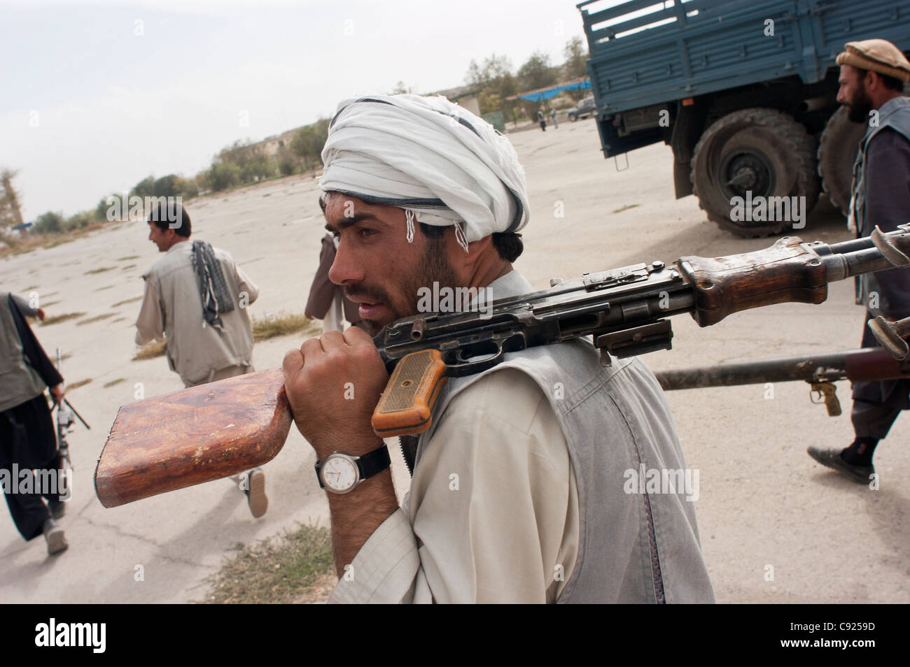 Former militia fighters arrive at an army base, as part of a UN DDR program in Kabul, Afghanistan Stock Photo