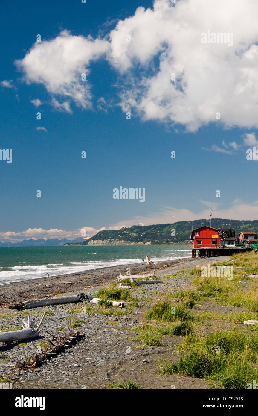 Scenic view of Kachemak Bay and businesses along the Homer boardwalk and beach, Kenai Peninsula, Southcentral Alaska, - Stock Image