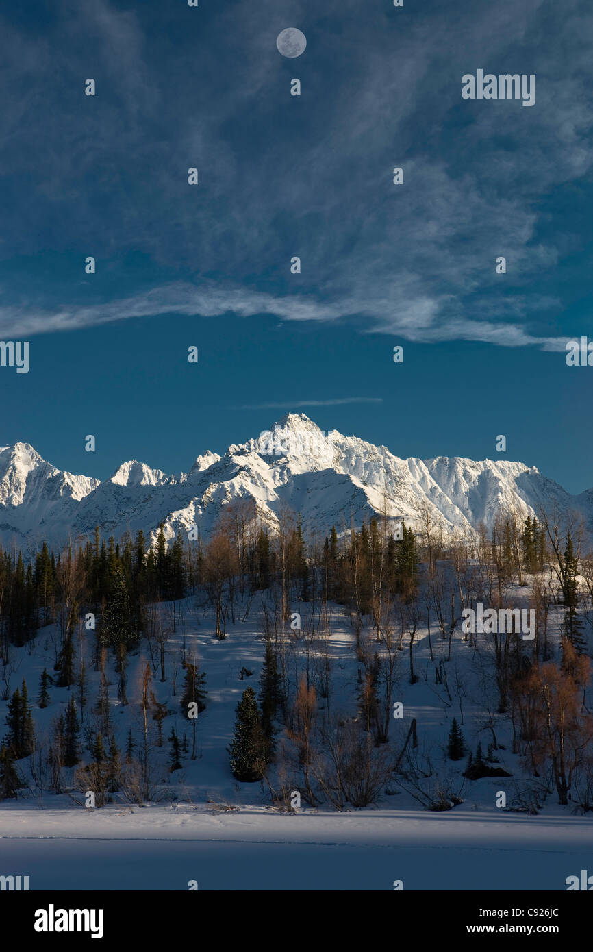 COMPOSITE: Scenic view of a full moon over the Chugach Mountains with Weiner Lake in the foreground, Southcentral Stock Photo