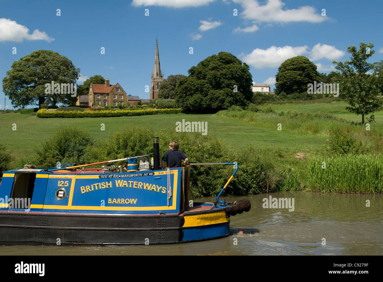 Grand Union Canal. A narrowboat passing below Braunston Church during the Braunston Historic Narrowboat rally 2011. - Stock Image