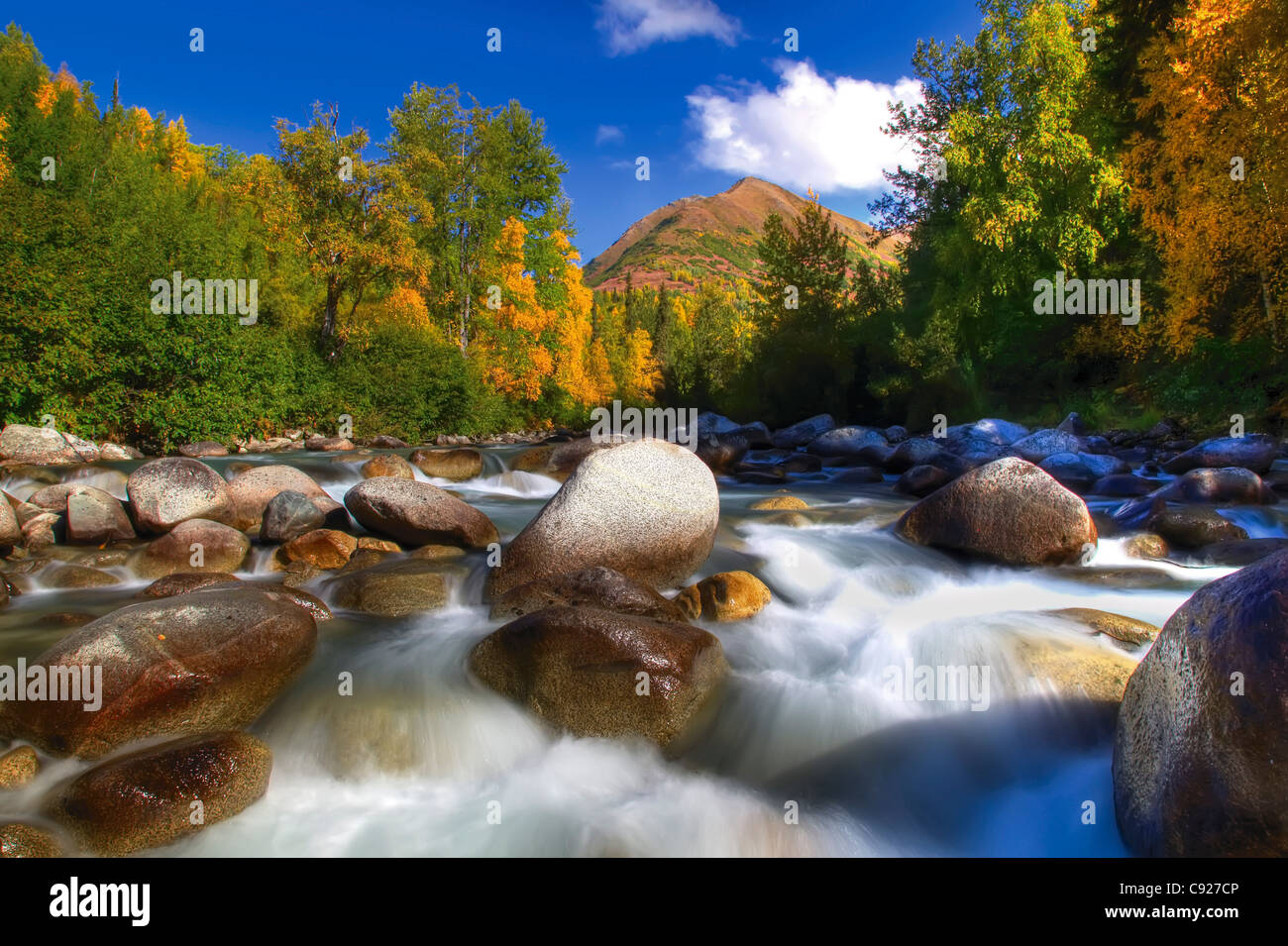 Low angle view of water rushing over rocks in Little Susitna River  Hatcher Pass, Southcentral Alaska - Stock Image