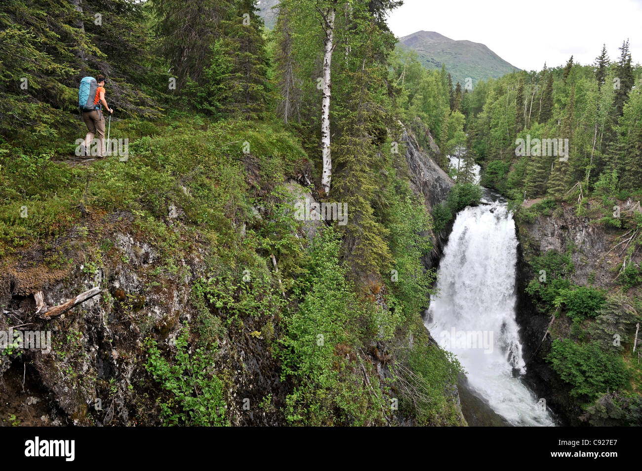 Woman hikes near Juneau Falls on the Resurrection Pass Trail in the Chugach National Forest, Southcentral Alaska, - Stock Image