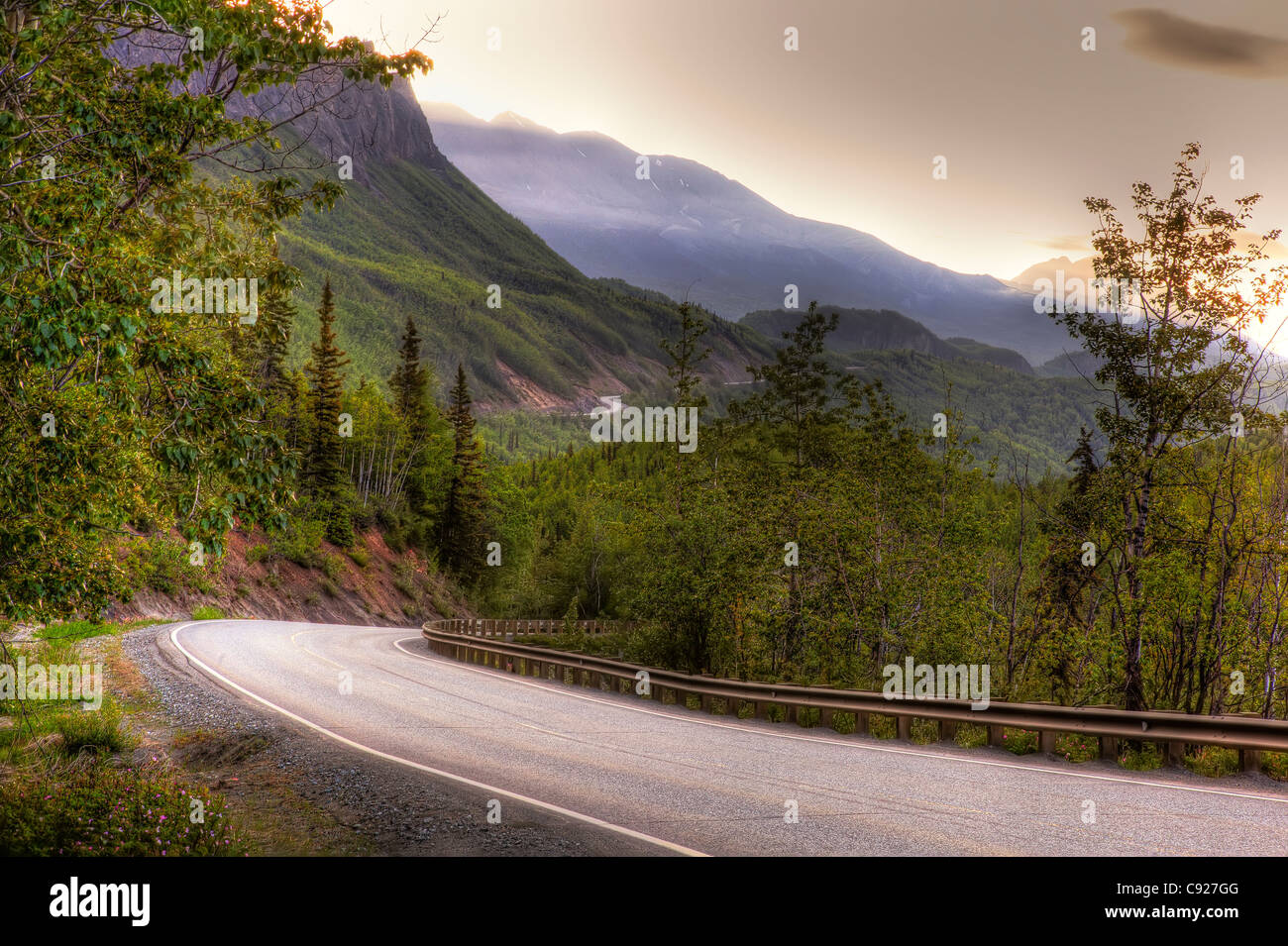 View of the Glenn Highway as it winds through the mountains on the way to Glennallen, Southcentral Alaska, Summer - Stock Image