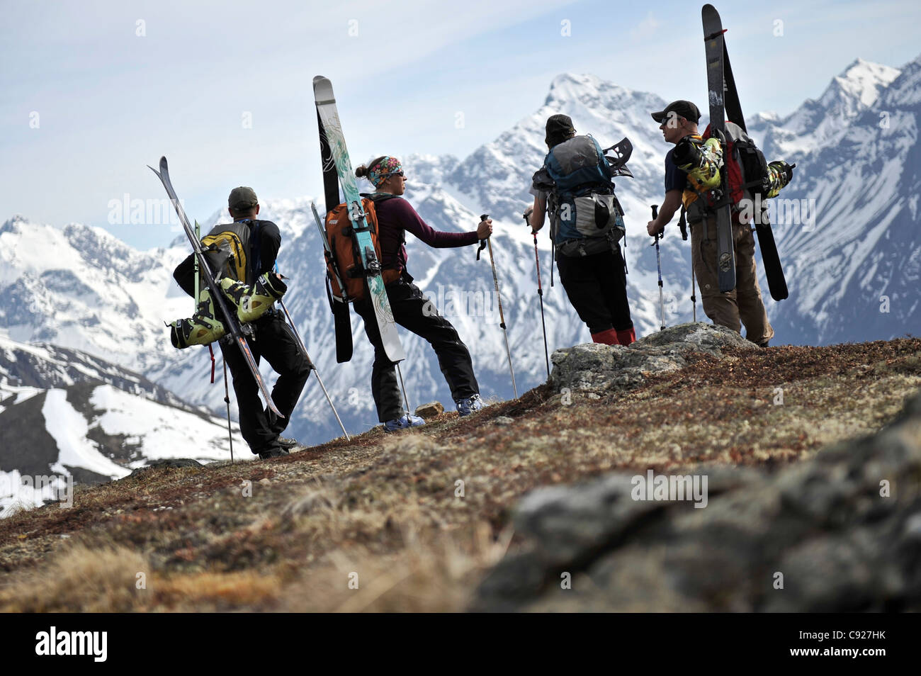 Group of backcountry skiers stand on a ridge of Raina Peak overlooking the Chugach Mountains, Alaska - Stock Image