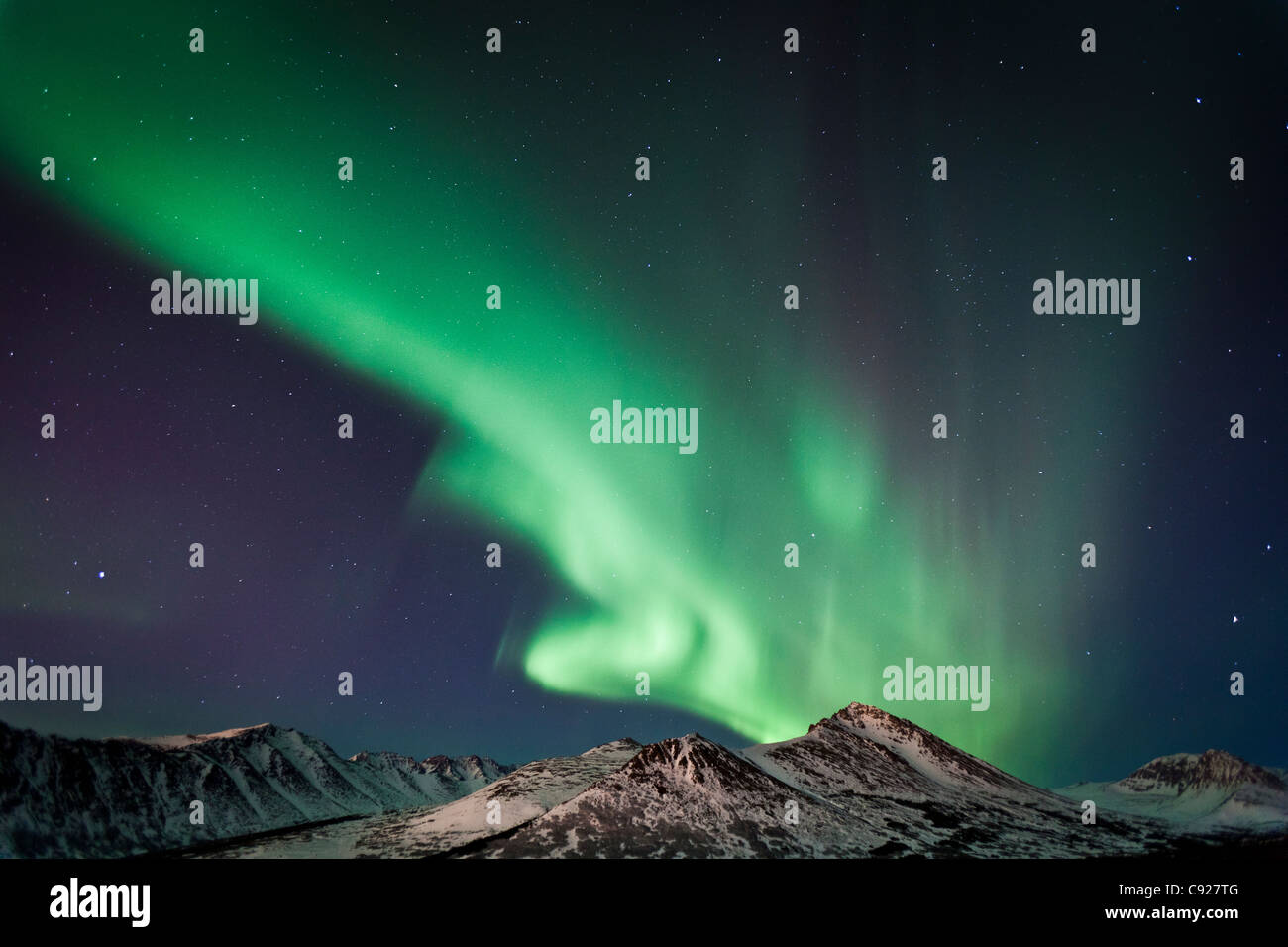 View of the Aurora Borealis over the Chugach Mountains, Anchorage, Southcentral Alaska, Fall - Stock Image