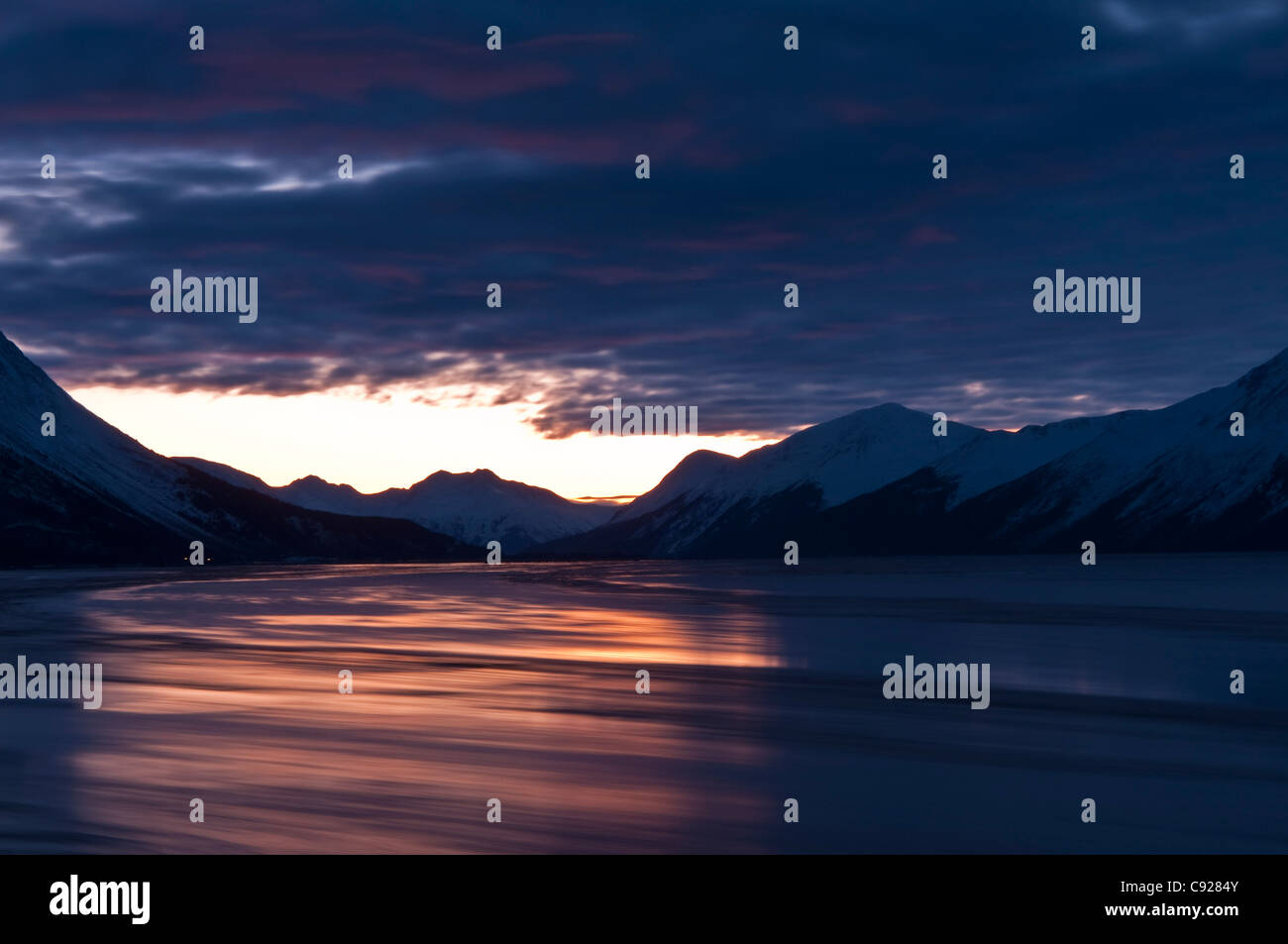 Outgoing tide just before sunrise along Turnagain Arm, Chugach Mountains, Southcentral Alaska, Winter - Stock Image