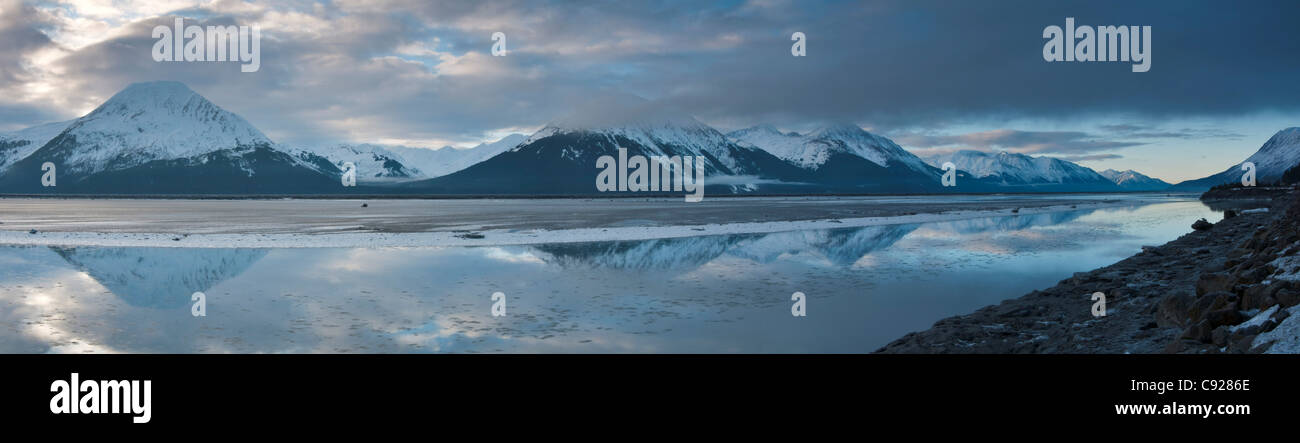 Scenic panorama of the Kenai Mountains reflected in Turnagain Arm, Southcentral Alaska, Winter - Stock Image