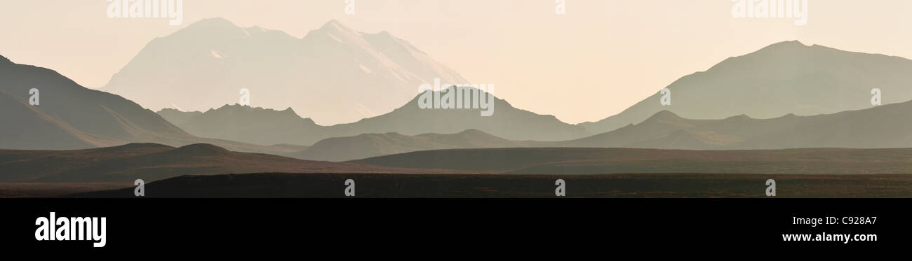 Panorama view of Mt. McKinley and the Alaska Range backlit on a hazy afternoon, Denali National Park & Preserve, - Stock Image