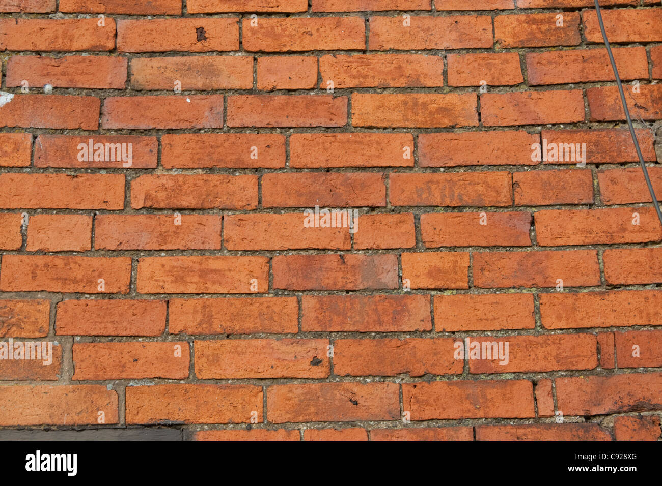 hand made red bricks in wall old farmhouse Colemans Hill Farm Mickleton UK - Stock Image