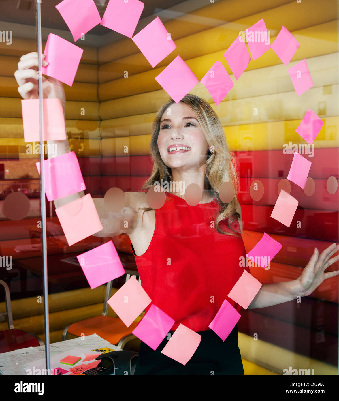 Businesswomen making heart with notes - Stock Image