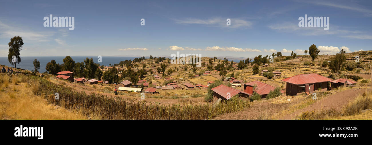 housing poor view lake titicaca house roof sky poverty basic blue cloud highest navigable taquile island puno horizon Stock Photo