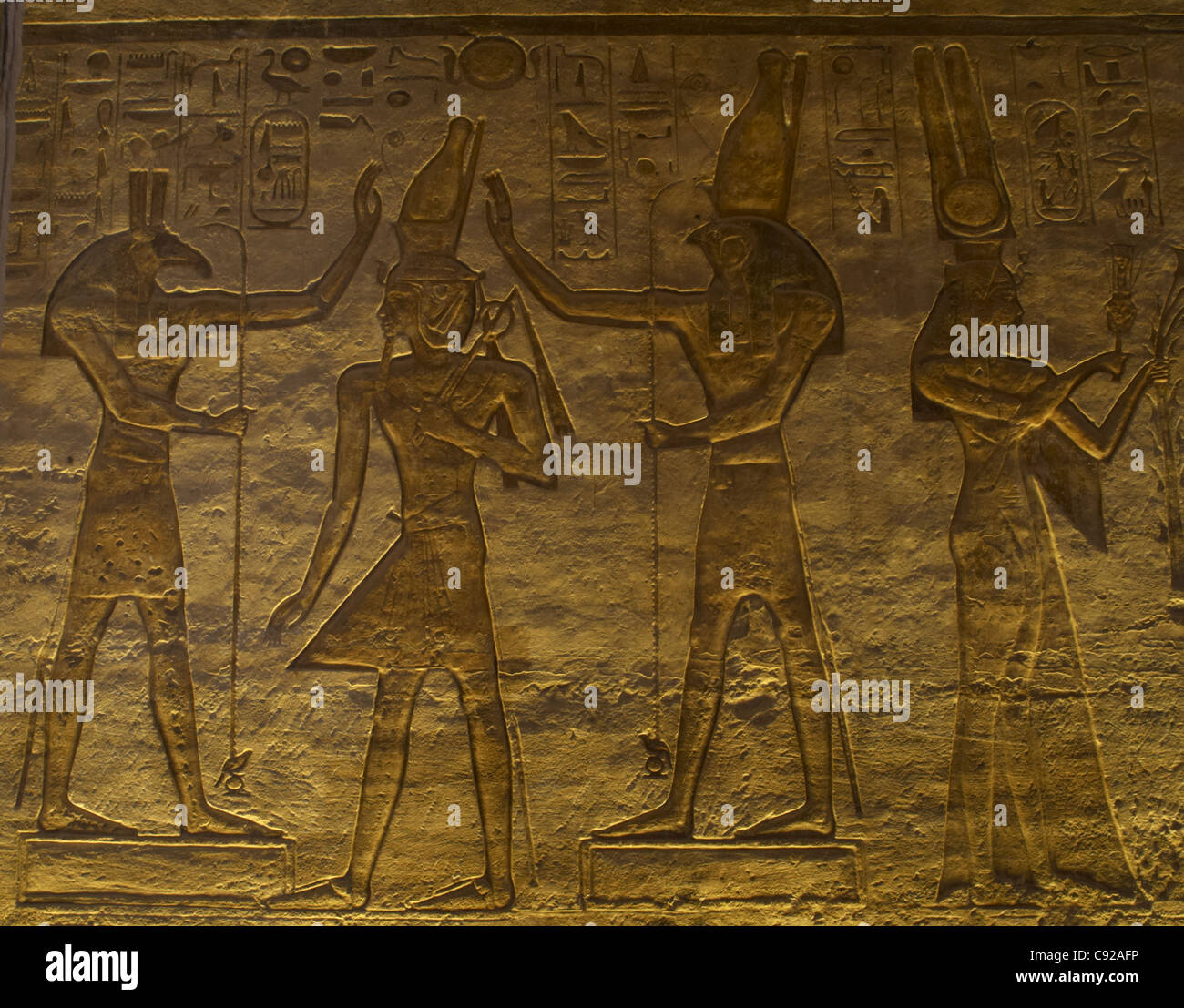 Egyptian art. Small Temple or Temple of Hathor. The gods Set (left) and Horus (right) adoring Ramses II. Abu Simbel. - Stock Image