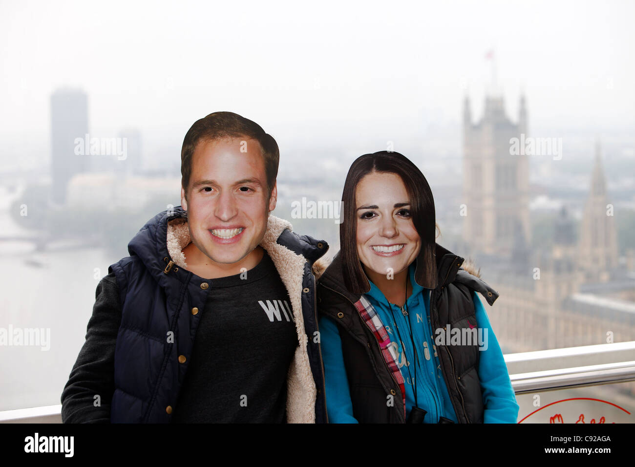 'Prince William and Kate Middleton' masked lookalikes in the London Eye, during the start of the Royal Wedding London, Stock Photo