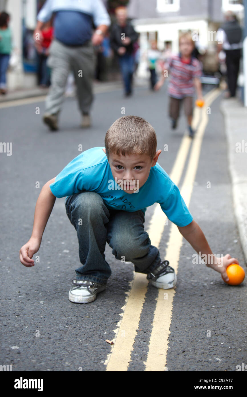 The quirky annual Totnes Orange Races, held on a Summer weekday morning on the High Street in Totnes, Devon, Englan - Stock Image