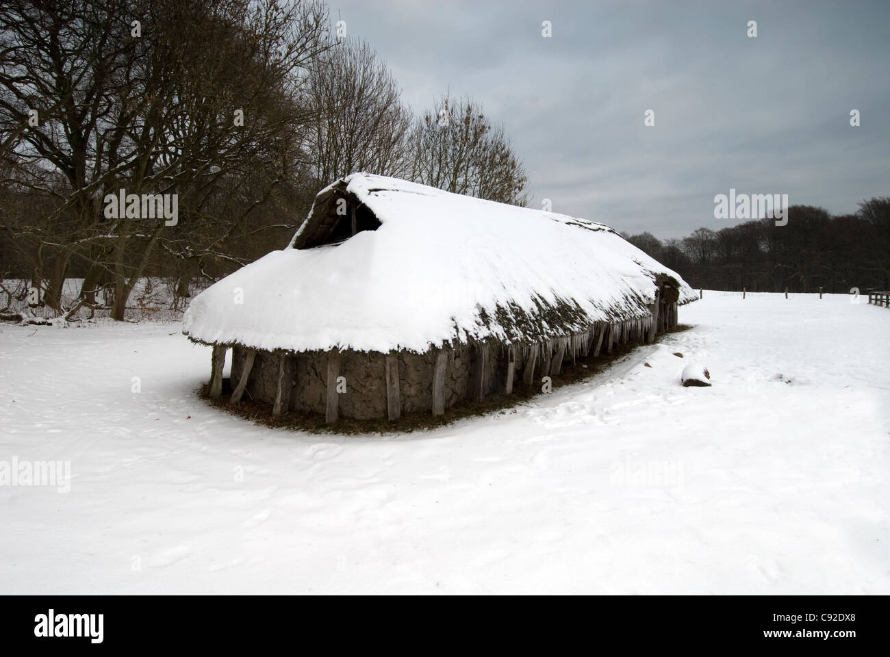 The Moesgard Museum features some reconstructions of historic Danish buildings, such as this Iron Age house. - Stock Image