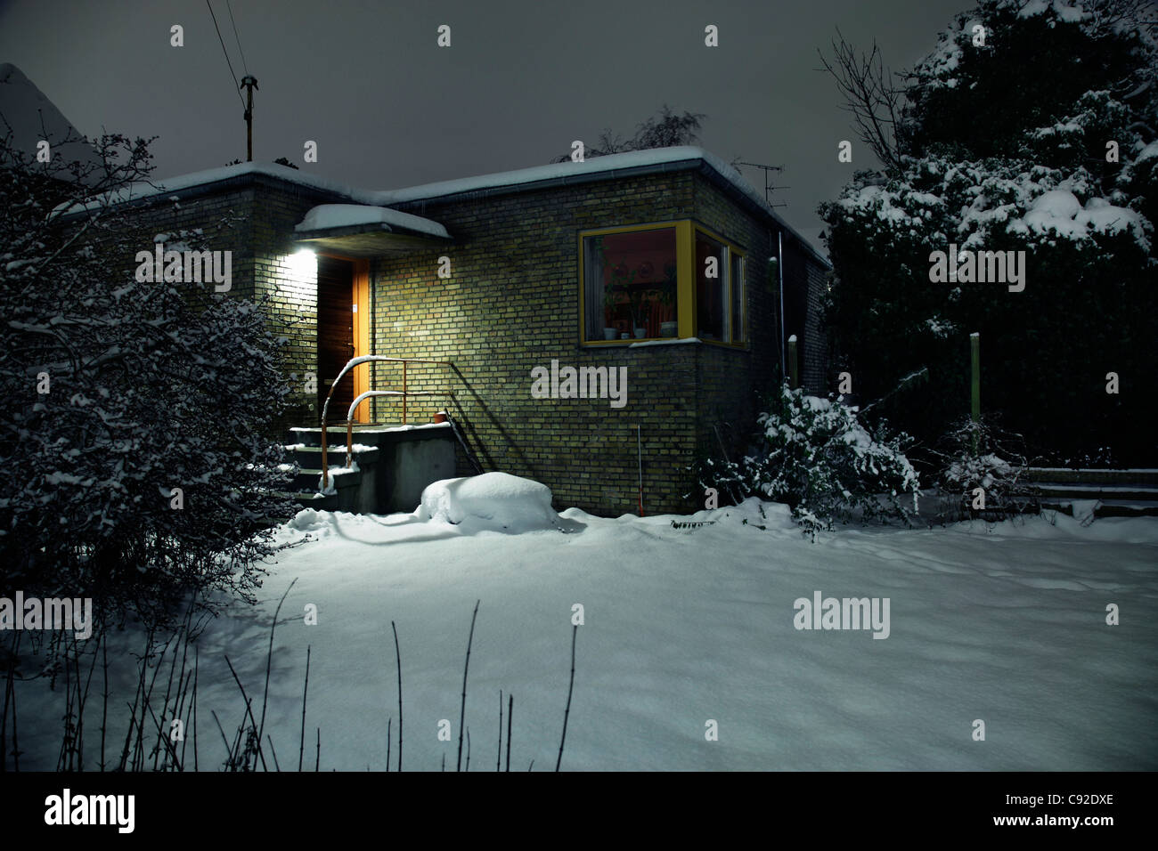 Snow covered house and front yard - Stock Image