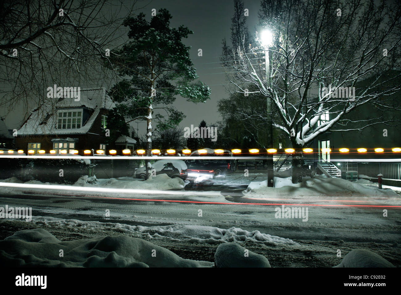 Time lapse view of snow covered street - Stock Image