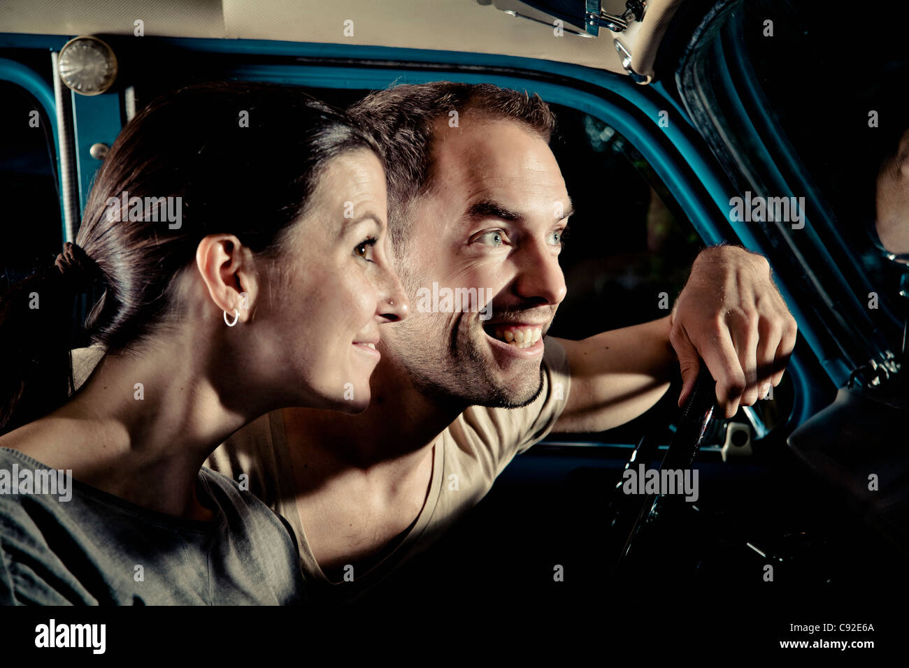 Smiling Couple Driving Car At Night Stock Photo Alamy