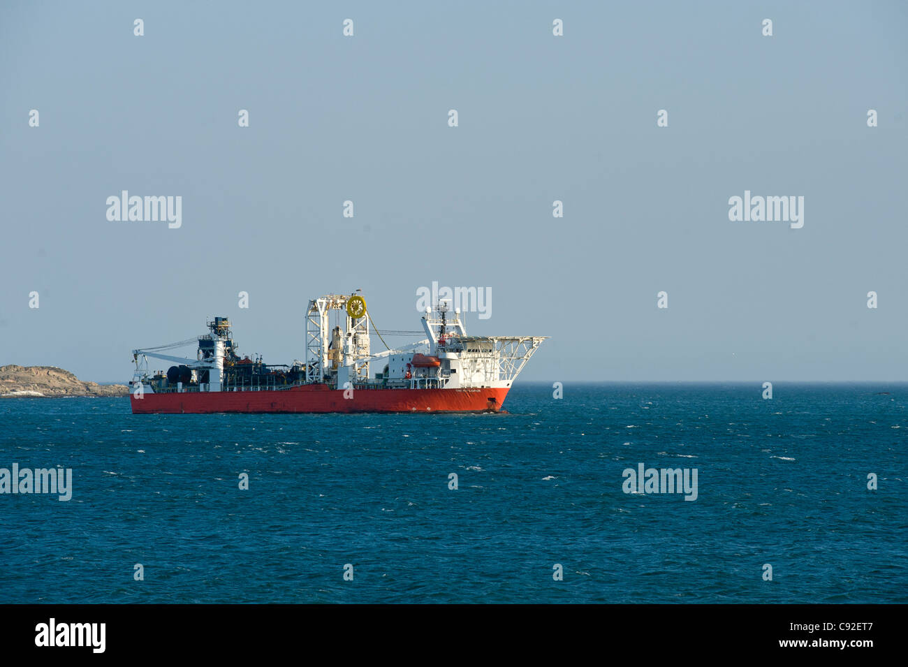 Off-shore diamond mining ship anchored in the bay of Luederitz in Namobia - Stock Image