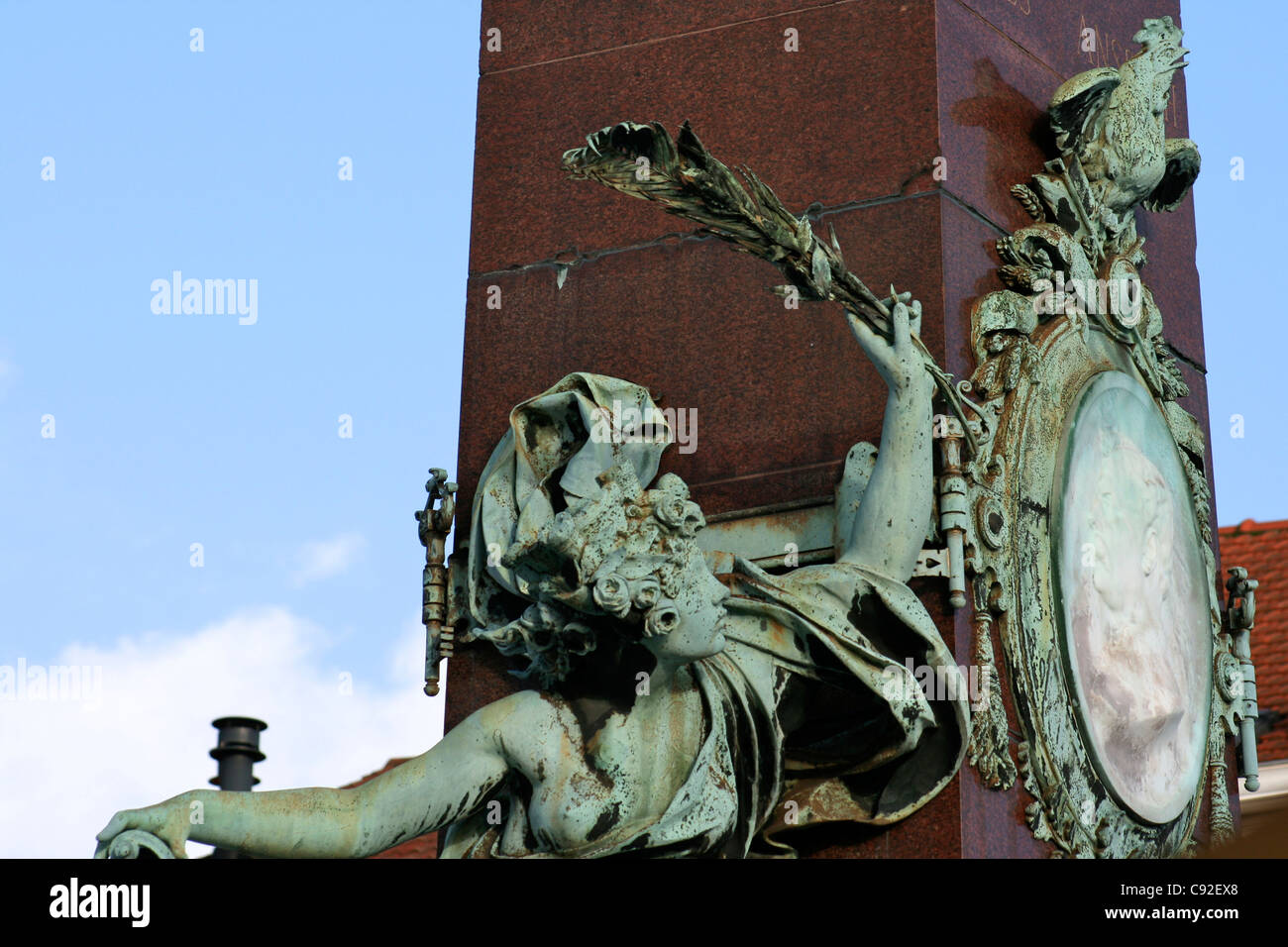 Bronze figure on the base of the granite monument of Archangel Michael slaying Satan on a granite column the patron - Stock Image