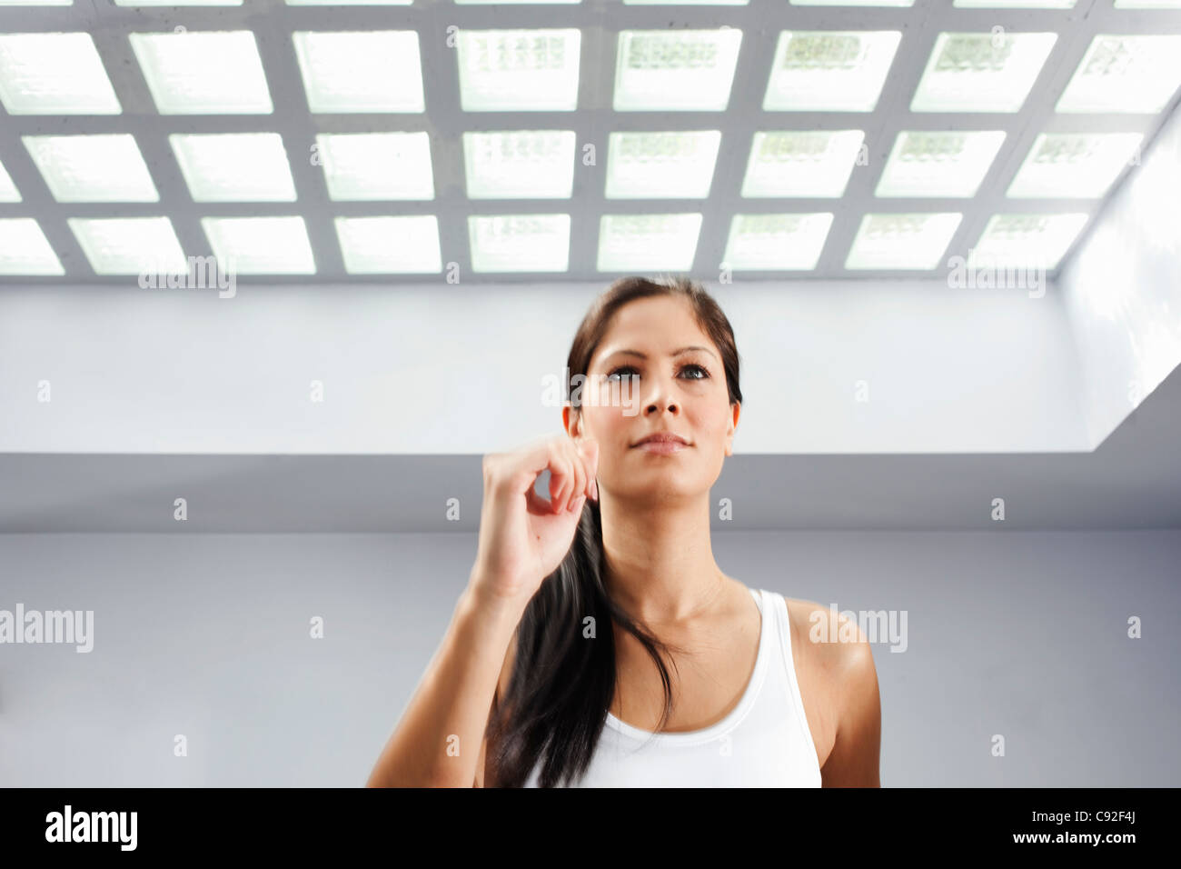 Woman exercising indoors - Stock Image