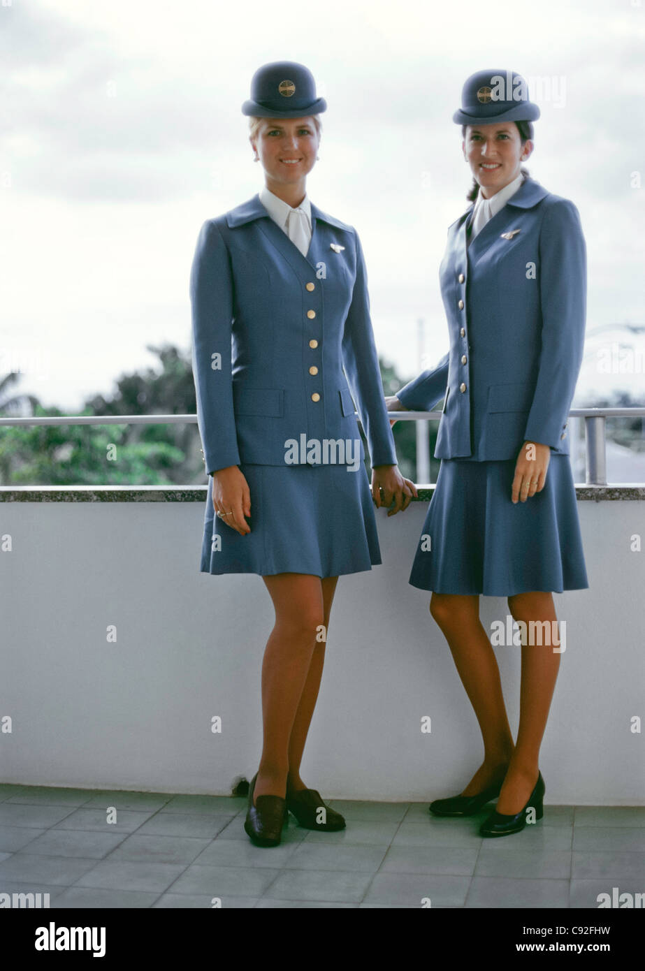 Two 1970's Pan Am Stewardesses In Uniform, Cheryl Acrey (L) and Patti McConville (R) - Stock Image