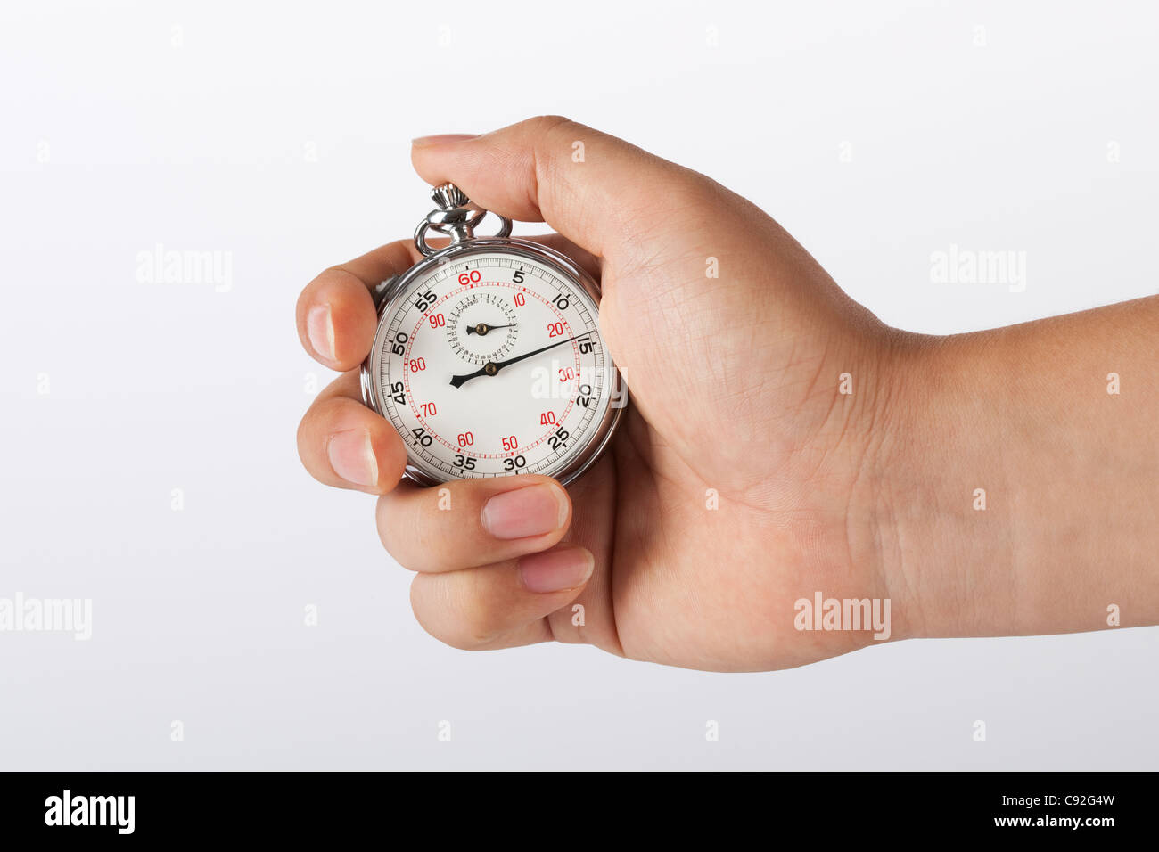 Hand holding stopwatch - Stock Image