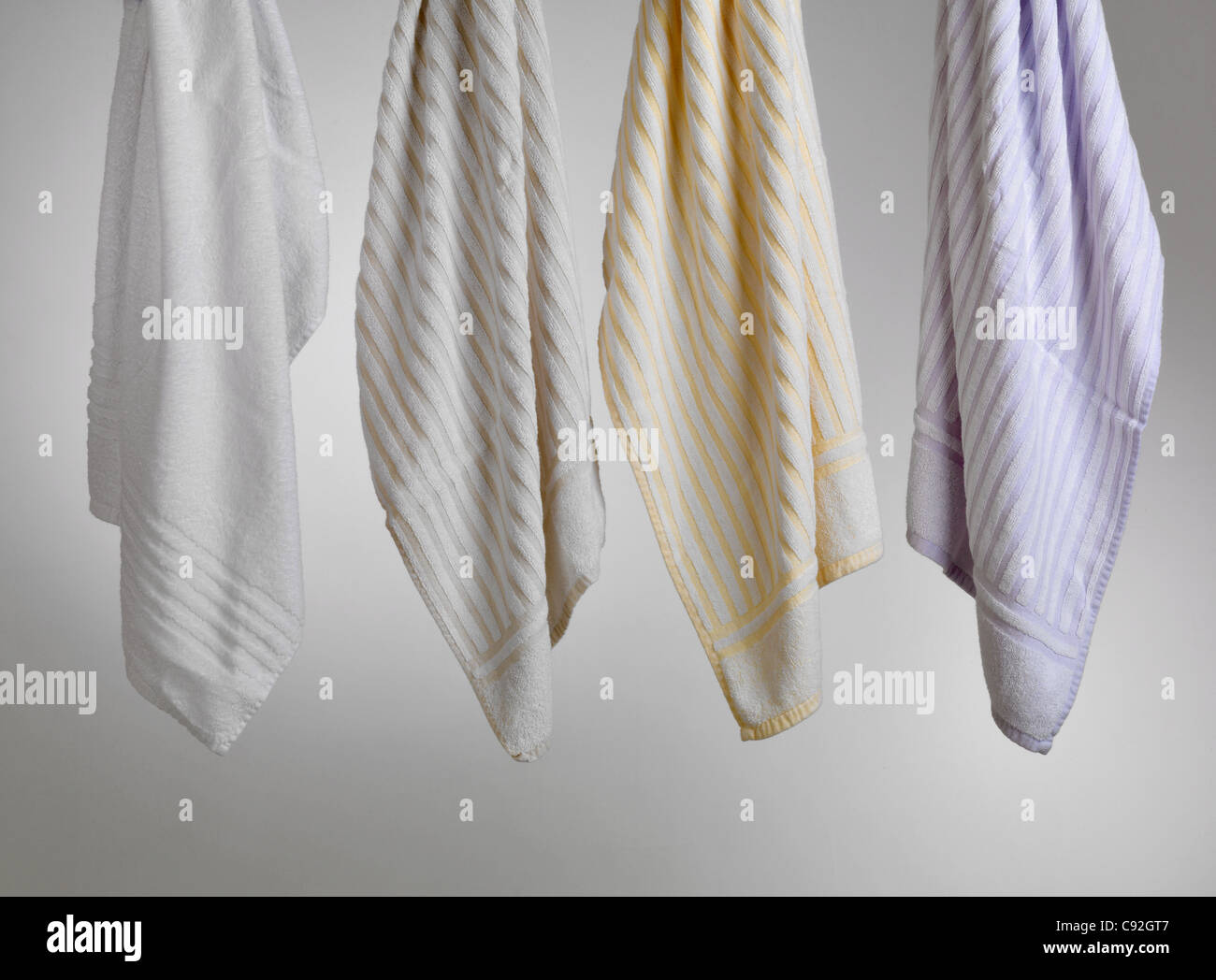white violet and yellow striped clean and dry towel on gray background Stock Photo