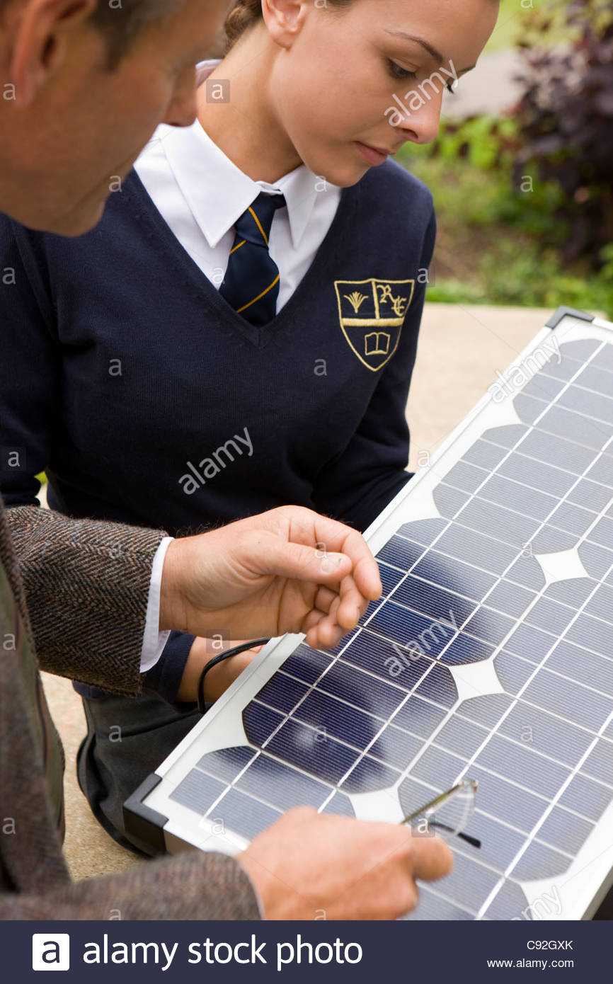Teacher and female student with solar panel - Stock Image