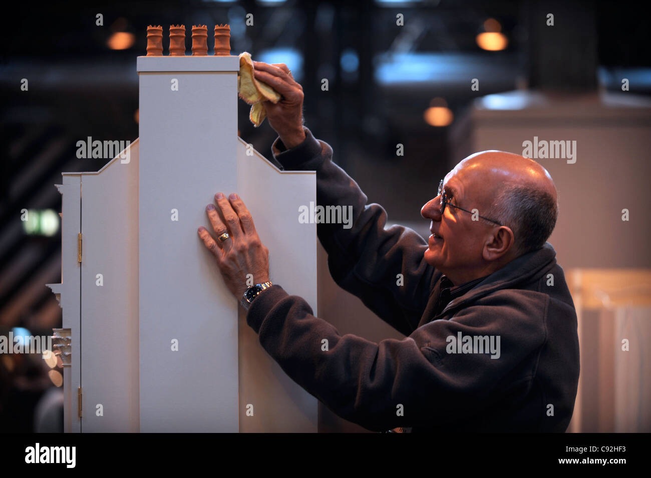 A miniatura enthusiast with his Georgian style dolls' houses at the miniature modelling Show at The NEC, Birmingham - Stock Image