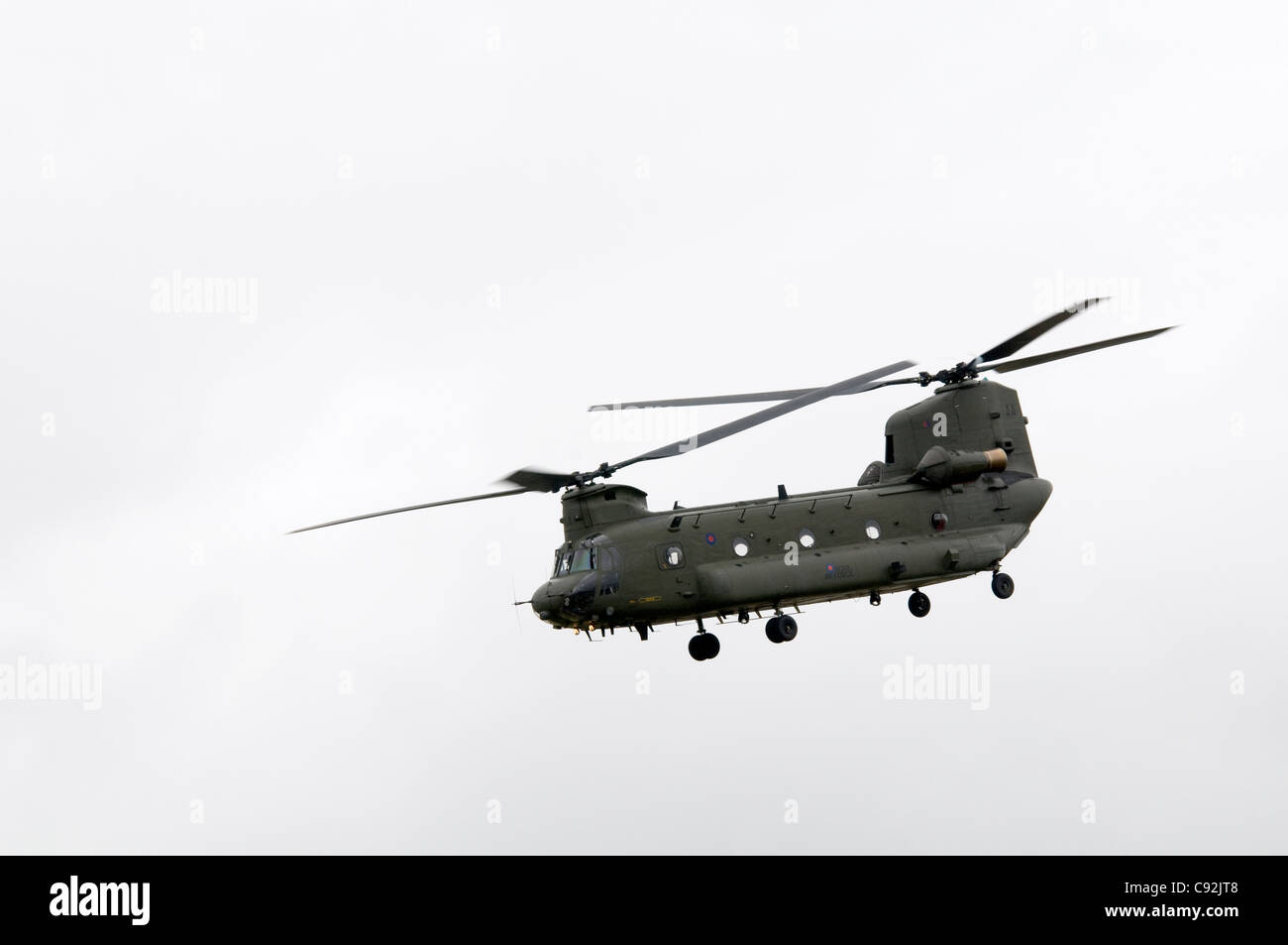 Chinook HC2  helicopter of the Royal Air Force doing flying display at Royal International Air Tattoo at RAF Fairford - Stock Image