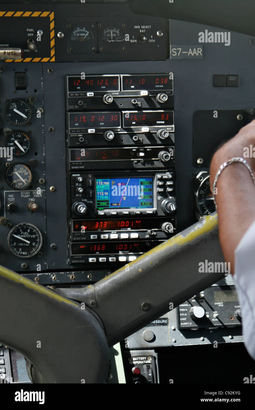 Garmin navigation control panel of the Air Seychelles DHC-6 twin otter twin propeller plane during flight showing Stock Photo