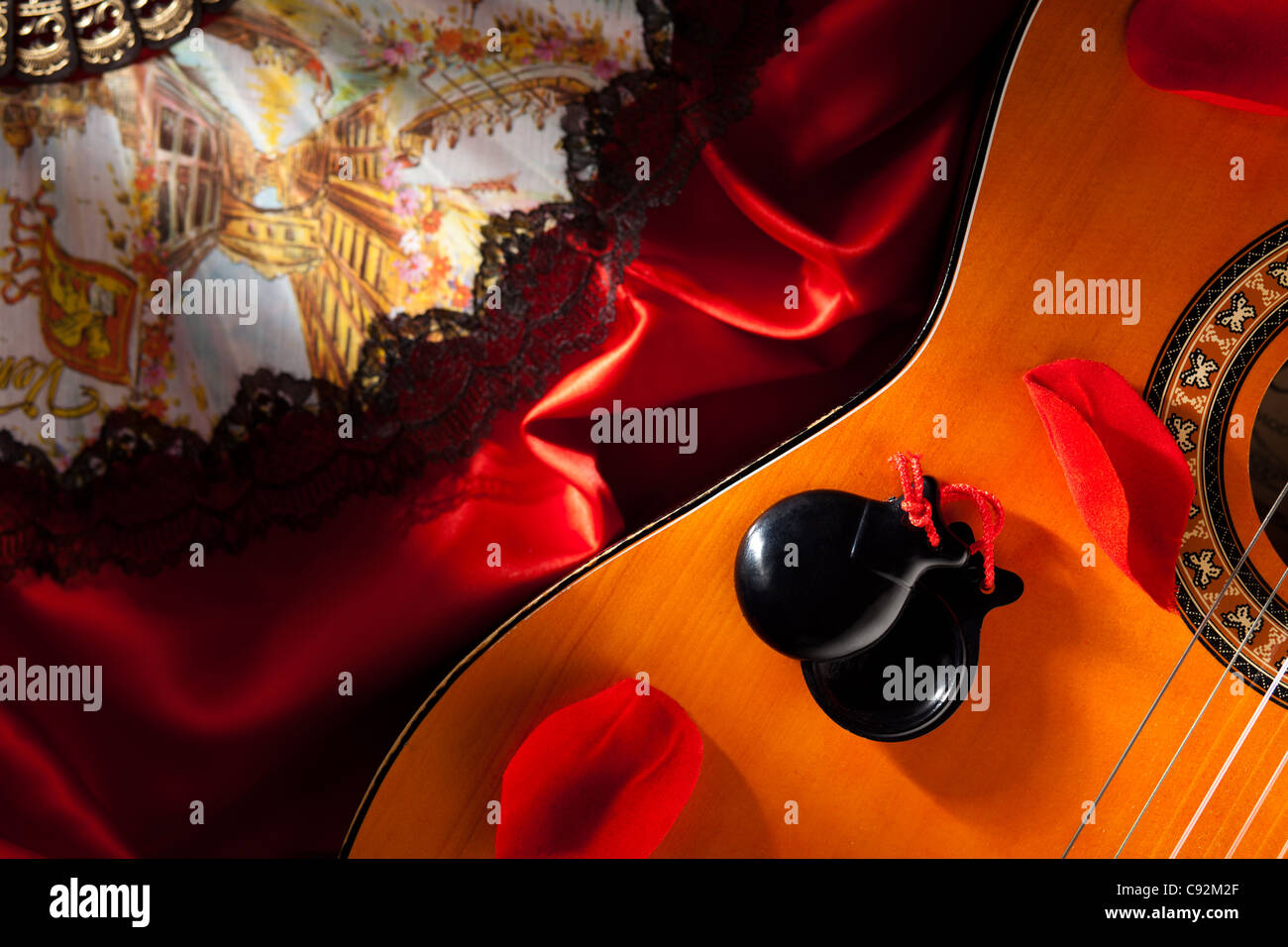 Castanets with Guitar, Hand Fan and Rose Petals - Stock Image