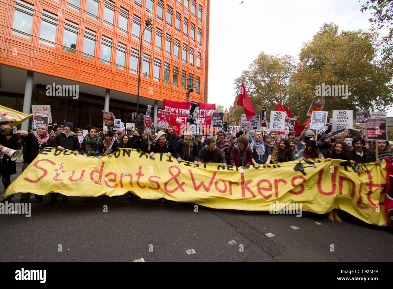 students protest in central London UK, about cuts to public spending and increase in tuition fees - Stock Image